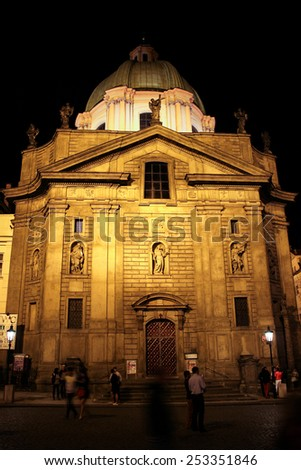 PRAGUE, CZECH REPUBLIC - JUNE, 21st, 2014: Saint Francis of Assisi Church famous landmark in Prague during night with lot of tourists in front of it on 21st June 2014.