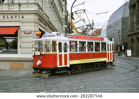 PRAGUE, CZECH REPUBLIC - JUNE 25, 2010: Vintage excursion tram goes on the central city street, Czech Republic, June 25, 2010. - stock photo