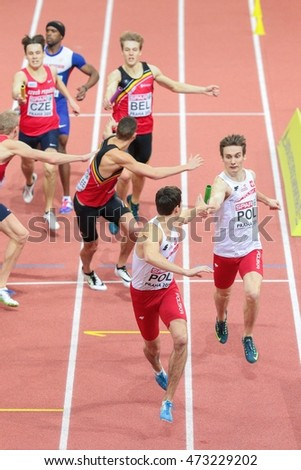 PRAGUE, CZECH REPUBLIC - MARCH 8, 2015: Karol Zalewski (Poland) and Rafal Omelko (Poland) compete in the men's 4x400m relay event of the European Athletics Indoor Championship.