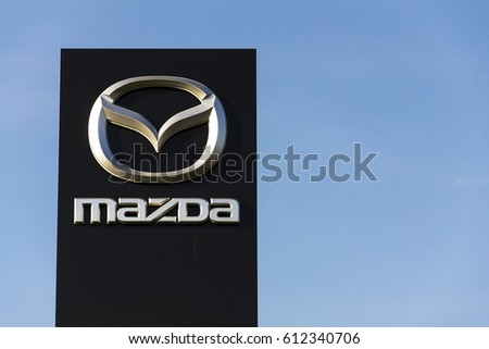 PRAGUE, CZECH REPUBLIC - MARCH 31: Mazda car company logo in front of dealership building on March 31, 2017 in Prague, Czech republic. Mazda set to launch new electric vehicle range by 2019.