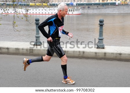 PRAGUE, CZECH REPUBLIC - MARCH 30: MUDR. Pirk runs the Hervis Half Marathon, March 30, 2012 in Prague, Czech republic. - stock photo