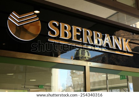 PRAGUE, CZECH REPUBLIC - MARCH 20, 2013: Sign of a new opened flagship branch of Sberbank in Prague, Czech Republic. Sberbank, the largest bank in Russia, started operations in Europe. - stock photo