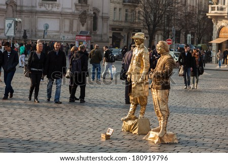 PRAGUE, CZECH REPUBLIC - MARCH 8th, 2014 - Live statues street artists perform on Old Town Square - stock photo
