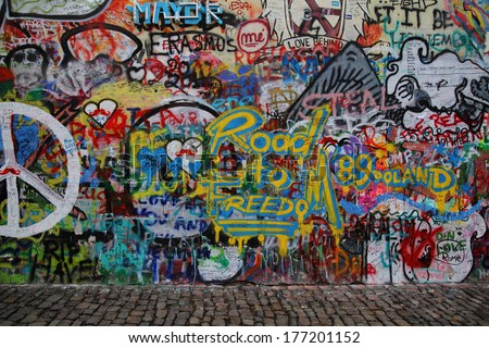 PRAGUE, CZECH REPUBLIC - MARCH 12:The Lennon Wall since the 1980 filled with John Lennon-inspired graffiti and texts from Beatles songs on March 12, 2012 in Prague, Czech Republic - stock photo