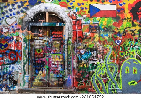 PRAGUE, CZECH REPUBLIC - MARCH 13:The Lennon Wall since the 1980 filled with John Lennon-inspired graffiti and texts from Beatles songs on March 13, 2015 in Prague, Czech Republic - stock photo
