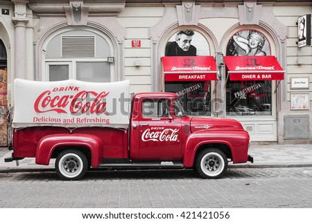 PRAGUE, CZECH REPUBLIC-MAY 15: a red retro car Ford F-100 with advertising inscription Coca Cola on board on the streets of Prague's Old Town May 15, 2015 - stock photo