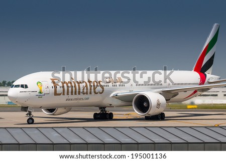 PRAGUE, CZECH REPUBLIC - MAY 22: Boeing 777-300ER Emirates taxis to terminal after landing at PRG Airport on May 22, 2014. Emirates is an airline based in Dubai. - stock photo