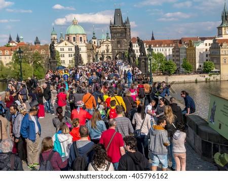 PRAGUE, CZECH REPUBLIC - MAY 02, 2015: Charles Bridge full of tourists, Prague, Czech Republic - stock photo