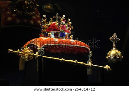 PRAGUE, CZECH REPUBLIC - MAY 10, 2013: Crown of Saint Wenceslas and the Royal Apple and Sceptre displayed at the exhibition of the Bohemian Crown Jewels in Prague, Czech Republic. - stock photo