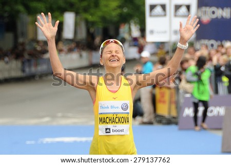 PRAGUE, CZECH REPUBLIC - MAY 3, 2015: Czech runner Sarka Machackova wins her category in the Volkswagen Marathon Prague, May 3, 2015 in Prague, Czech republic. - stock photo