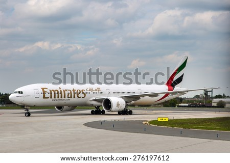 PRAGUE, CZECH REPUBLIC - MAY 03: Emirates Boeing 777-36N/ER taxis at PRG Airport on May 03,2015. Emirates is one of two flag carriers of the UAE along with Etihad Airways and is based in Dubai. - stock photo