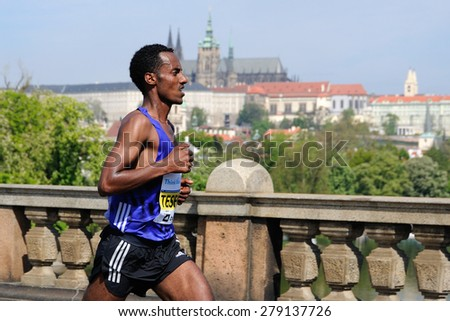 PRAGUE, CZECH REPUBLIC - MAY 3, 2015: Ethiopian runner Belay Tesfaye runs the Volkswagen Marathon Prague, May 3, 2015 in Prague, Czech republic. - stock photo