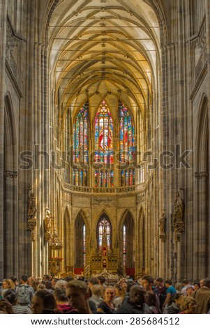 PRAGUE, CZECH REPUBLIC - MAY 22, 2015: Large Group of Tourist Admire the Interior of St. Vitus Cathedral in Castle Hradcany.