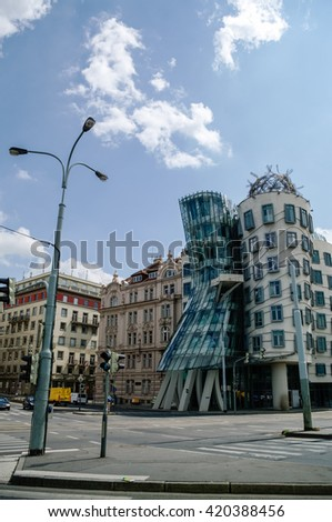 Prague, Czech Republic - May 8, 2012: Modern building, also known as the Dancing House, designed by Vlado Milunic and Frank O. Gehry stands on the Rasinovo Nabrezi. - stock photo