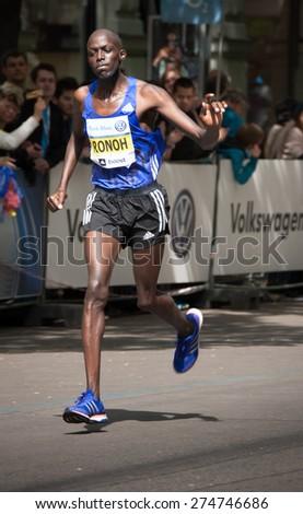 PRAGUE, CZECH REPUBLIC - MAY 3, 2015: runner Ronoh, finishing the Volkswagen Prague Marathon 2015 and his last 100 m through Parizska Street to the Old Town Square finish - stock photo