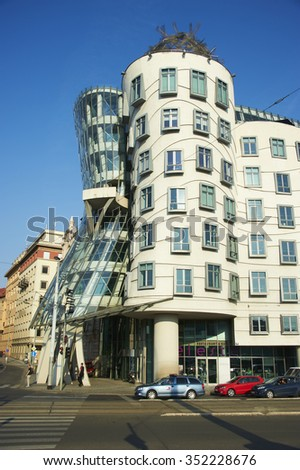 PRAGUE, CZECH REPUBLIC - May 10, 2014. Street view with famous Dancing House , called Fred and Ginger House after the famous dancers.  - stock photo