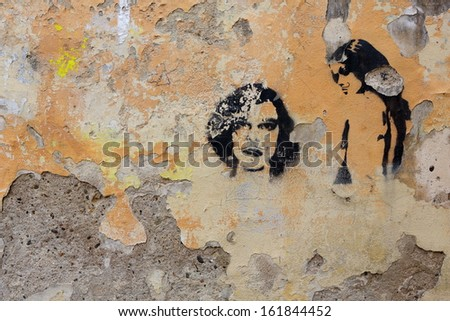PRAGUE, CZECH REPUBLIC - NOVEMBER 05: old wall at city park Kampa regularly filled with graffitti on November 05, 2013 in Prague, Czech Republic - stock photo