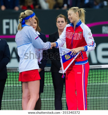 PRAGUE, CZECH REPUBLIC - NOVEMBER 14 : Petra Kvitova & Maria Sharapova shake hands ahead of the 2015 Fed Cup Final