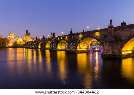 Prague, Czech Republic - October 31st, 2015: View at The Charles Bridge and Vltava river in Prague in dusk at sunset, Czech Republic