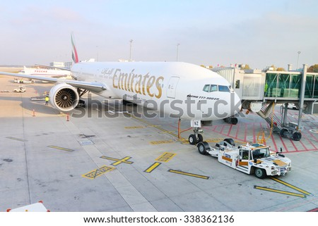 PRAGUE, CZECH REPUBLIC - OCTOBER 26, 2015: The Boeing B777 300/200 LR Emirates docked on Vaclav Havel International Airport. Modern jet aircraft for 550 passengers. - stock photo