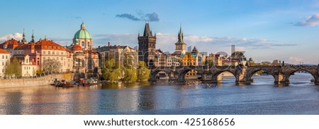 Prague, Czech Republic panorama with historic Charles Bridge and Vltava river on sunny day. - stock photo