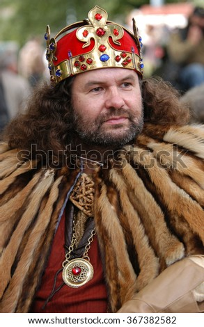 PRAGUE, CZECH REPUBLIC - SEPTEMBER 24, 2004: Bearded man dressed as King Charles IV of Bohemia wearing the Wenceslas Crown attends the wine festival Vinohradske Vinobrani in Prague, Czech Republic.  - stock photo