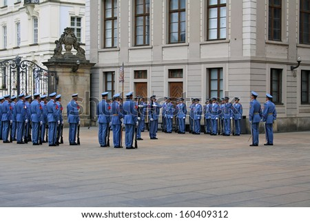 PRAGUE, CZECH REPUBLIC - SEPTEMBER 15, 2013: Changing of the Guards ceremony on September 15, 2013 in Prague. It takes place in Prague Castle at 12.00 daily and attracts many tourists.