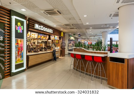 PRAGUE, CZECH REPUBLIC - SEPTEMBER 23, 2015: McDonald's restaurant in Flora mall. McDonald's, founded in 1940, is world's largest chain of fast food serving millions of customers in 119 countries. - stock photo