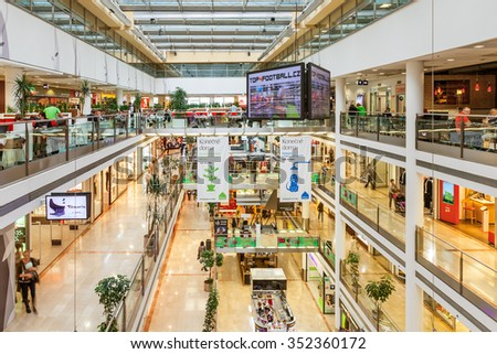 PRAGUE, CZECH REPUBLIC - SEPTEMBER 23, 2015: Palac Flora shopping mall interior. Opened in 2003, contains 4 floors, 120 shops, Cinema City & IMAX theater and is one of the largest malls in Prague. - stock photo