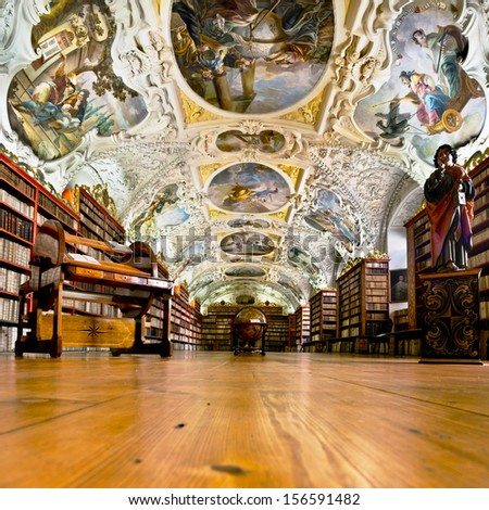 PRAGUE, CZECH REPUBLIC - SEPTEMBER 19: The Theological Hall in Strahov monastery in Prague, constructed in 1720s. Picture taken on September 19, 2013. One of the finest library interiors in Europe. - stock photo