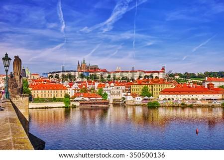 PRAGUE,CZECH REPUBLIC- SEPTEMBER 13, 2015: View of Prague Castle and Charles Bridge-famous historic bridge that crosses the Vltava river in Prague, Czech Republic.  - stock photo