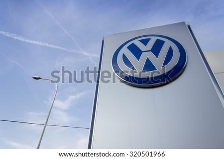 PRAGUE, CZECH REPUBLIC - SEPTEMBER 24: Volkswagen car maker logo on a building of dealership on September 24, 2015 in Prague, Czech republic. Great emission scandal raises around number of VW cars. - stock photo