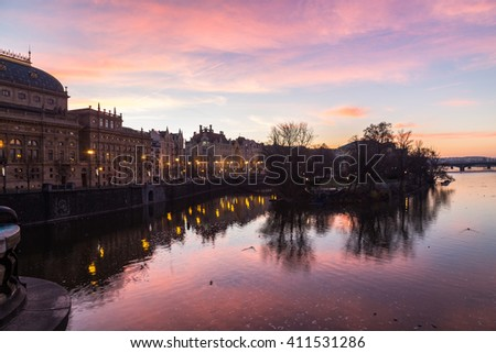 PRAGUE, CZECH REPUBLIC - 6TH DECEMBER 2015: Colourful Sunrise in Prague. The outside of buildings can be seen along the Vltava River. - stock photo