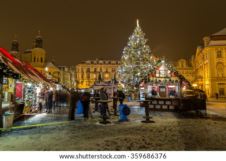 PRAGUE, CZECH REPUBLIC - 6TH JANUARY 2016: Part of the Christmas Market at Old Town Square in Prague during the festive season. The Christmas tree, market stalls and people can be seen. - stock photo