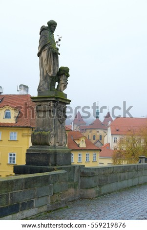 Prague, Czechia - November, 21, 2016: monument on Charles bridge in a center of Prague, Czechia