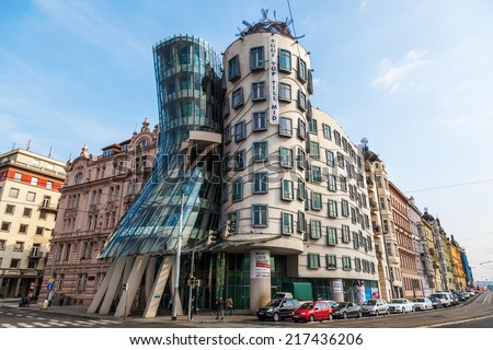 PRAGUE, CZECHIA - SEPTEMBER 03: Dancing House on September 03, 2014 in Prague. The Dancing House also called Fred and Ginger was designed 1992 by Vlado Milunic and Frank Gehry and completed 1996 - stock photo