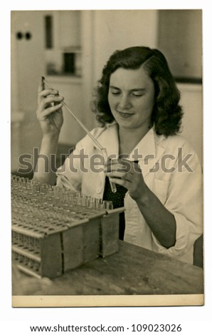PRAGUE, CZECHOSLOVAK REPUBLIC, CIRCA 1950 - young woman in laboratory - circa 1950 - stock photo