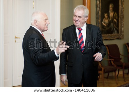 PRAGUE - FEBRUARY 5: Czech president Vaclav Klaus (left) and new-elected president Milos Zeman (right) during their meeting in Prague castle, Czech republic, February 5, 2013 - stock photo