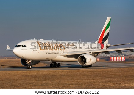 PRAGUE - FEBRUARY 26: Emirates Airbus A330 airliner taxes for take off on February 26, 2011 in Prague,Czech Republic. Emirates is rated as a top 10 best airlines in the world flying on youngest fleet. - stock photo