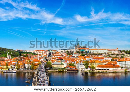 Prague: Mala Strana,  Charles bridge and Prague castle view from Old Town bridge tower over Vltava river in daytime. Prague, Czech Republic - stock photo