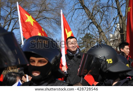 PRAGUE - MARCH 29: Supporters and opposers to the Chinese president protest against closer relationships between the Czech Republic and China during the Jinping´s visit on Tuesday, March 29, 2016. - stock photo