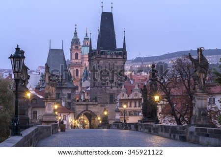 PRAGUE - NOVEMBER  1: Charles bridge in Prague is the most popular destination for tourists around the world especially at sunrise, November 1, 2015, Czech Republic - stock photo