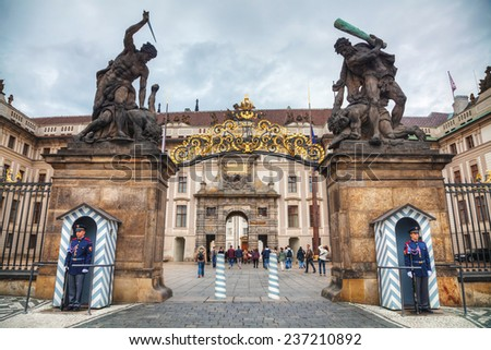 PRAGUE - OCTOBER 17: Entrance to the Prague castle on October 17, 2014 in Prague, Czech Republic. Prague Castle is the official residence and office of the President of the Czech Republic. - stock photo