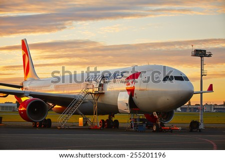 PRAGUE - OCTOBER 21: Maintenance Airbus of Czech Airlines at Vaclav Havel Prague Airport in the Czech Republic on October 21, 2014. A330 registration OK-YBA is first type in fleet of Czech Airlines. - stock photo
