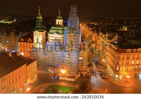 Prague Old Town main square and St Nicholas church under repair works, Czech Republic - stock photo