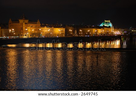 Prague panorama by night - lights mirroring in river - stock photo