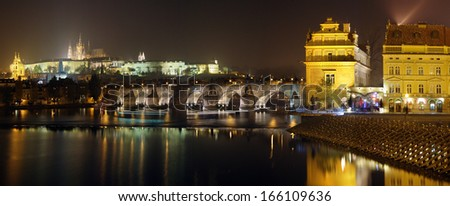 Prague panorama. View of the Charles Bridge and Castle in Prague at night. - stock photo