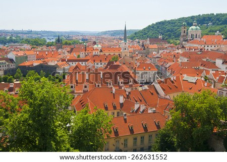 Prague panorama with sityscape of gothic and baroque churches, red roofs (czech republic) - stock photo