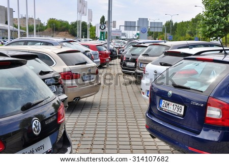 PRAGUE, THE CZECH REPUBLIC, 02.08.2015 - parking cars in front of car store in Prague - stock photo