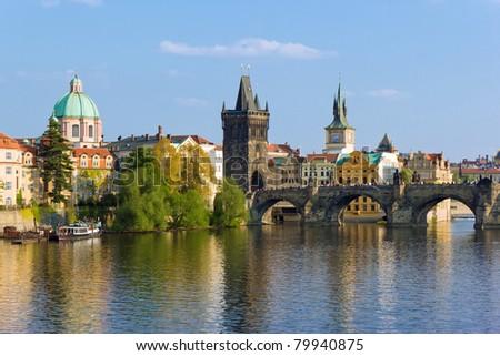 Prague towers over Vltava river - stock photo